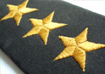 photo of military lapel with three gold stars
